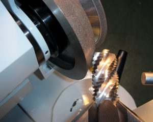 Grinding screw tap bit by hand